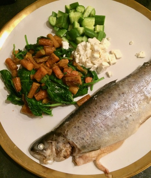 Baked trout with roasted carrots and spinach